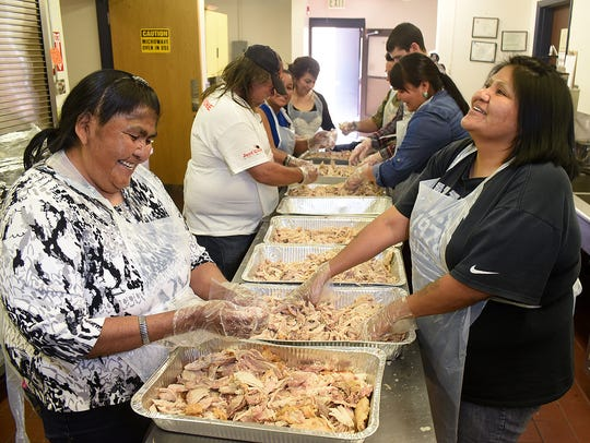 Salvation Army volunteers Nellie Haceesa, left, and Dorothy Rafael of Nageezi help prepare Thanksgiving meals for the public last year at the Farmington Civic Center.