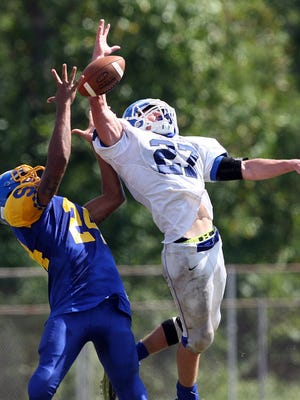 Action photos of Shore Regional at Spotswood football on Saturday September 19, 2015.Shore Regional's # 27Jack Britton (right) breaks up a pass intended for Spotswood's # 24 (left) Marlon Hart during the 1st half of play.