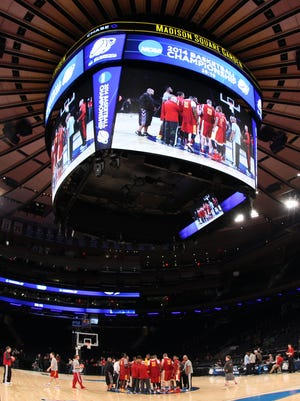 The Iowa State Cyclones huddle at mid-court during practice for the east regional of the 2014 NCAA Tournament at Madison Square Garden.