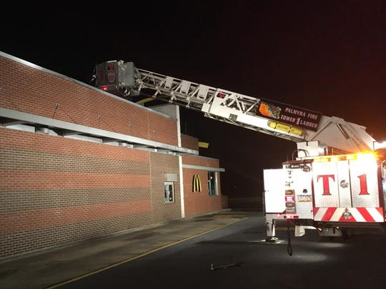 A Palmyra fire crew responds to a commercial building