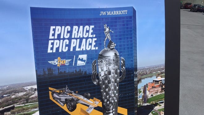 Officials from Sport Graphics, the JW Marriott and the 100th Running Host Committee presented this artist's rendering of the Borg-Warner Trophy and an Indy car on the hotel.