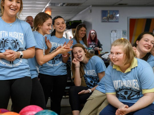 The North High School girls team cheer for Haleigh Shadrick (not pictured) as she takes her turn during the Champions Together bowling match held at River City Recreation bowling alley in Evansville, Ind., Tuesday, Feb. 27, 2018. The team of special needs students and their student buddies competed against other teams from Central, Castle and Harrison High Schools.