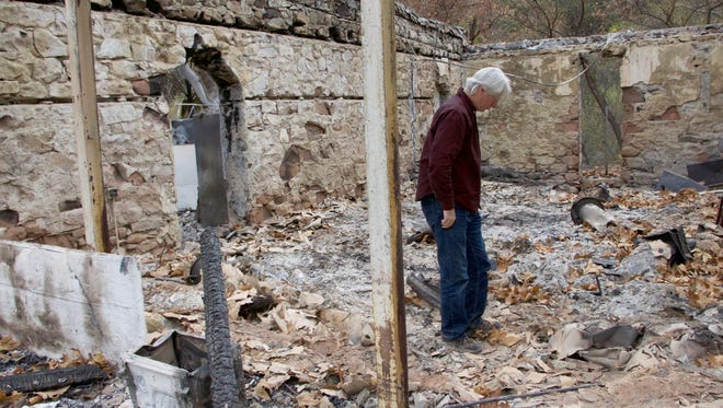 Ray Powers walks in the debris at the post office at Matilija Hot Springs after the Thomas Fire burned through the property.