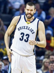 Memphis Grizzlies center Marc Gasol slaps himself after hitting a shot against San Antonio Spurs during second quarter action in the sixth game of their NBA first round playoff series at the FedExForum.