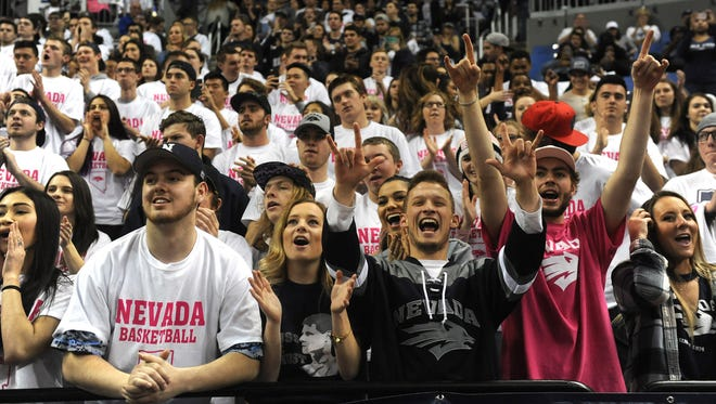 Nevada fans cheer while the Wolf Pack takes on New Mexico on Saturday. The crowd was the 12th largest in school history.