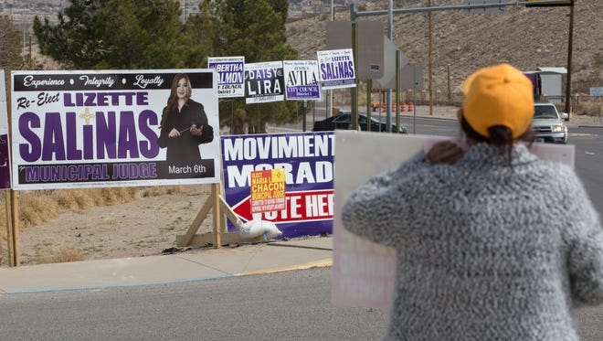 A Supporter of Maria Chacon, stand with a sign near signs for other candidates Lizette Salinas, Daisy Lira, Bertha Salmon and Jessica Aliva in the Municipal Judge race along with Sunland Park City Council candidates, Tuesday March 6, 2018 in Sunland Park.