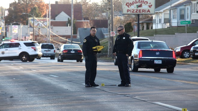 Police investigate a shooting Thursday nearAbraham Lincoln High School in Des Moines,