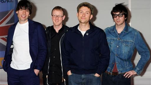 """In this Feb. 21, 2012 file photo, from left, Alex James, Dave Rowntree, Damon Albarn, Graham Coxon, of Blur arrive for the Brit Awards 2012 at the O2 Arena in London.  Blur's first album as a foursome for 16 years, """"The Magic Whip"""" is the result of time spent together in a Hong Kong studio in 2013.  (AP Photo/Jonathan Short)"""