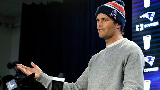 """FILE - In this Jan. 22, 2015, file photo, New England Patriots quarterback Tom Brady speaks at a news conference about the NFL investigation into deflated footballs, in Foxborough, Mass. An NFL investigation has found that New England Patriots employees likely deflated footballs and that quarterback Tom Brady was """"at least generally aware"""" of the rules violations. The 243-page report released Wednesday, May 6, 2015, said league investigators found no evidence that coach Bill Belichick and team management knew of the practice. (AP Photo/Elise Amendola, File)"""