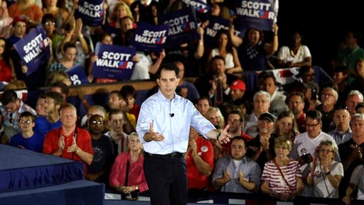 Wisconsin Gov. Scott Walker speaks to supporters as he announces he is running for the 2016 Republican presidential nomination at the Waukesha County Expo Center, Monday, July 13, 2015, in Waukesha, Wis. (AP Photo/Nam Y. Huh)