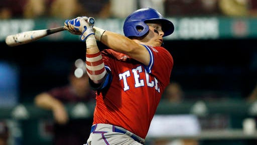 Louisiana Tech's Jordan Washam swings and misses a Mississippi State pitch during their NCAA Regional Baseball Tournament championship game at Dudy Noble Field in Starkville, Miss., Sunday, June 5, 2016. (AP Photo/Rogelio V. Solis)