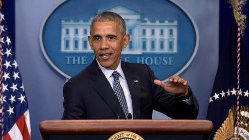 FILE - In this Nov. 14, 2016, file photo, President Barack Obama speaks during a news conference in the Brady press briefing room at the White House in Washington. The Reublican-led House is pushing ahead with a $611 billion defense policy bill that prohibits closing the prison at Guantanamo Bay, Cuba, forbids the Pentagon from trimming the number of military bases and awards U.S. troops their largest pay raise in six years.