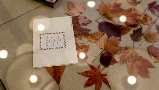 An envelope of leaves mailed from Canada to San Diego so a long-distance paramour could experience changing seasons in Southern California is displayed at the Los Angeles branch of the Museum of Broken Relationships Wednesday, Dec. 28, 2016 in Los Angeles. The Museum of Broken Relationships displays artifacts from failed unions, most of them mundane under ordinary circumstances.