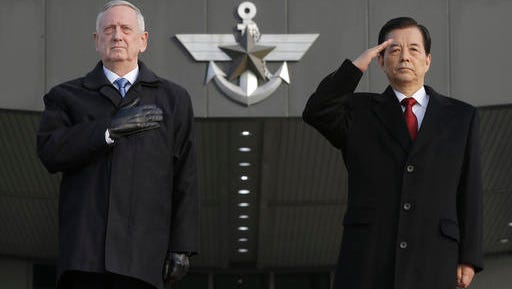 U.S. Defense Secretary Jim Mattis, left, and South Korean Defense Minister Han Min Koo salute during a welcome ceremony for Mattis at Defense Ministry in Seoul, South Korea, Friday, Feb. 3, 2017.