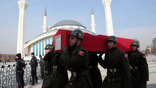 Military honour guard carry the coffin of Mahmut Uslu, one of five Turkish soldiers killed in an attack by IS militants around the Syrian town al Bab on Tuesday night, during a ceremony in Ankara, Turkey, Thursday, Feb. 9, 2017.