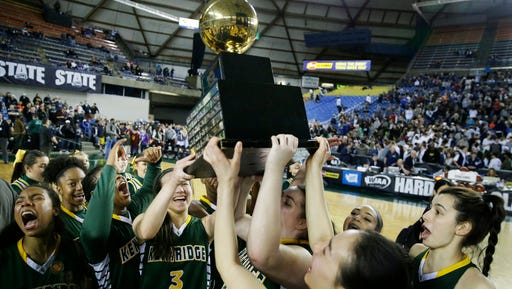 Kentridge players lift the trophy after they won the girls' Class 4A high school basketball championship against Glacier Peak, Saturday, March 4, 2017, in Tacoma, Wash. (AP Photo/Ted S. Warren)