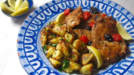This March 6, 2017 photo shows Greek-style roasted lemon potatoes in New York. This dish is from a recipe by Sara Moulton.