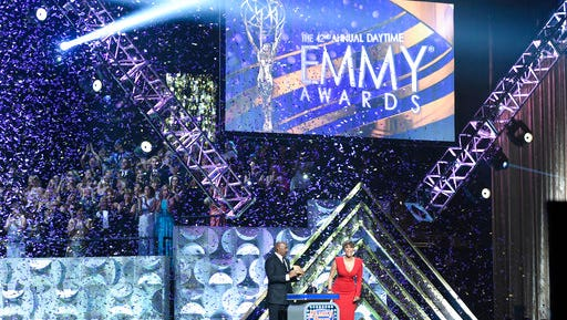 """FILE - In this April 26, 2015 file photo, Steve Harvey, left, and Tyra Banks appear at the 42nd annual Daytime Emmy Awards in Burbank, Calif.  CBS led with 70 nominations overall while its daytime drama """"The Young and the Restless"""" led with 25 nods when nominations were announced Wednesday, March 22, 2017, for the 44th Annual Daytime Emmy awards.  The awards ceremony will air April 30."""