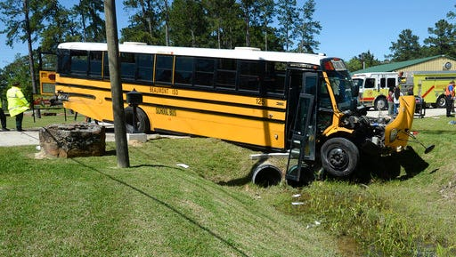 More than 20 Charlton-Pollard Elementary students and one adult were hospitalized when a Beaumont school district bus was involved in a traffic accident on U.S. 69 in Lumberton, Texas, Wednesday, April 5, 2017. The bus was taking several dozen Charlton-Pollard Elementary School students and several adults back to school from a Big Thicket field trip. Beaumont school district spokeswoman Nakisha Burns says one student was airlifted to a trauma hospital in Houston. (Guiseppe Barranco/The Beaumont Enterprise via AP)