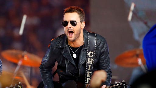 FILE - In this Nov. 24, 2016, file photo, country music singer Eric Church performs at halftime during an NFL football game between the Washington Redskins and Dallas Cowboys in Arlington, Texas. Church is one of many musicians using new technology, including 360-degree cameras, virtual reality musical experiences and vertical videos, to reach the smart phone generation of music fans who are discovering new music on their phones and tablets.