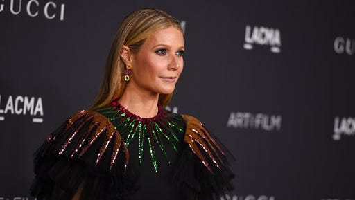 FILE - In this Oct. 29, 2016, file photo, Gwyneth Paltrow arrives at the 2016 LACMA Art + Film Galain Los Angeles. Paltrow and former Vogue editor Anna Wintour are teaming up to take the actress' Goop website to print, magazine publisher Conde Nast announced on April 28, 2017.
