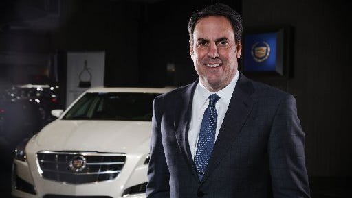 General Motors President of North America Mark Reuss poses for a photo near a 2014 Cadillac CTS on Wednesday January 8, 2014 at the Renaissance Center in downtown Detroit.