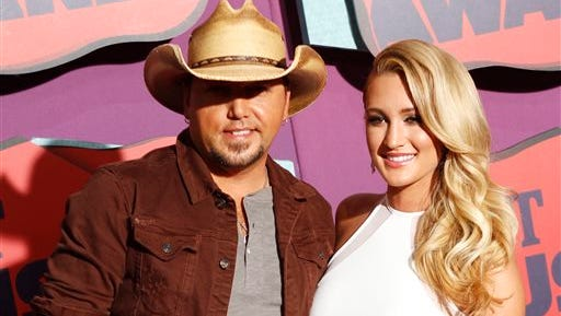 """Jason Aldean, left, and Brittany Kerr arrive at the CMT Music Awards in Nashville, Tenn. Aldean and former """"American Idol"""" contestant Brittany Kerr are engaged to be married. A publicist for Aldean confirmed on Thursday that the couple had gotten engaged, which was first reported by TMZ. Aldean filed for divorce from his wife, Jessica, last year after pictures surfaced of him and Kerr in Los Angeles bar."""
