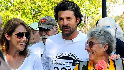In this file photo, actor Patrick Dempsey, center, prepares to start the Survivor Walk with his mother, Amanda, right, and Amgen Breakaway from Cancer Award winner Laura Davis  in Lewiston, Maine, on the first day of the Dempsey Challenge.  The sixth Dempsey Challenge gets underway Saturday without the woman who provided the inspiration for the fundraiser and a cancer center.  Amanda Dempsey passed away in March.