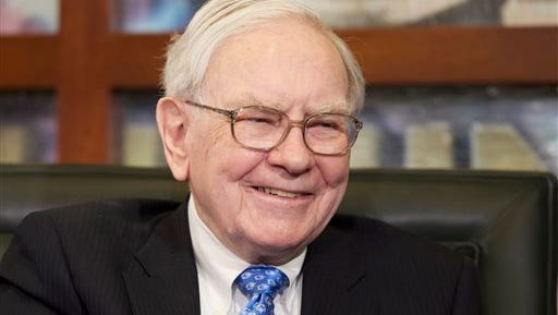 In this May 6, 2013 photo, Warren Buffett appears during a television interview in Omaha, Neb.