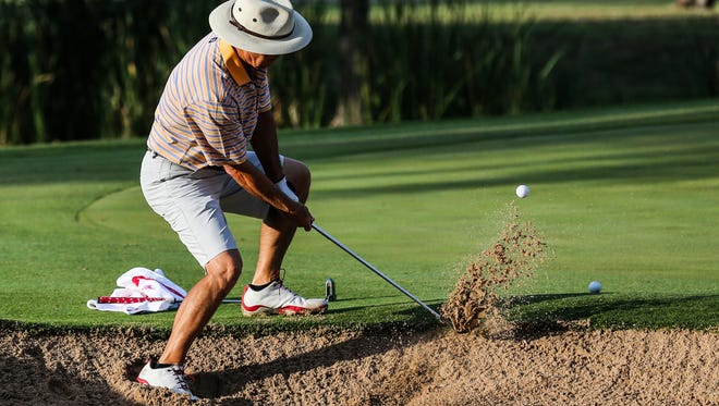 Jerry Hudgins hits the ball out of the bunker during the San Angelo Country Club Men's Partnership Thursday, June 22.