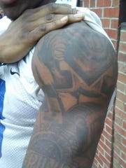 Memphis wide receiver Anthony Miller displays the tattoos