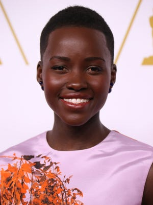 Lupita Nyong'o arrives at the 86th Oscar nominees luncheon at the Beverly Hilton Hotel in Beverly Hills, Calif., on Feb. 10, 2014.