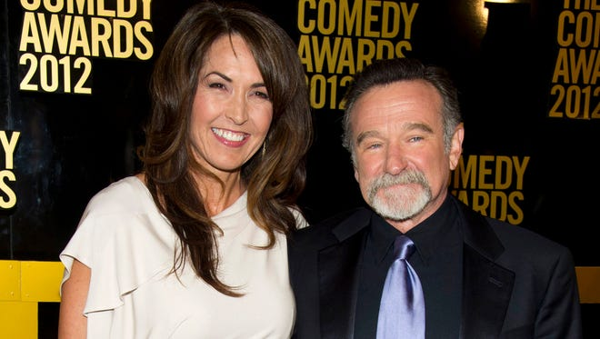 In this April 28, 2013, file photo, Robin Williams and his wife, Susan Schneider, arrive at The 2012 Comedy Awards in New York. Schneider said Williams' medical afflictions would have claimed his life within three years.