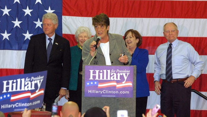 Richmond Mayor Sally Hutton introduces Joe Kernan, right, who introduced President Bill Clinton to a large crowd at Fire Station No. 1 on March 18, 2008. Former Indiana first ladies Judy O'bannon, next to Clinton, and Maggie Kernan joined the party onstage.