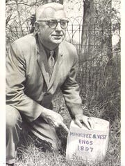 Surveyer Noel Walton is shown with a county line marker in this Kentucky Post photo.