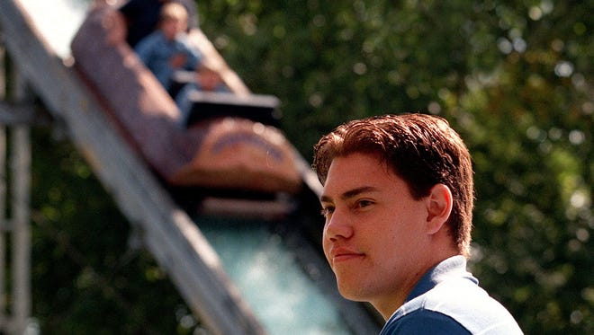 Matt Heeren-Parker, then 18, runs the Log Ride at Adventureland on Aug. 21, 1997.