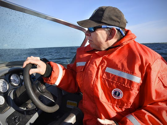 Mille Lacs National Wildlife Refuge Manager Walt Ford drives a boat to Hennepin Island on Lake Mille Lacs. The island is about a quarter-acre.