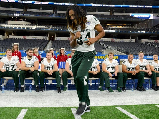 MSU freshman wide receiver Felton Davis III dances as his teammates watch during Cotton Bowl media day. The media had one hour with the entire team Tuesday in Arlington, Texas.