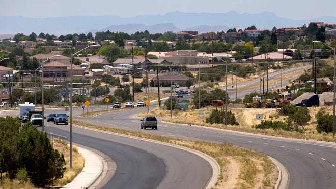 A section of Pinon Hills Boulevard in Farmington is being resurfaced using a money-saving method known as hot in-place recycling.