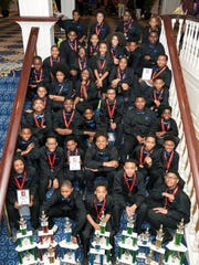 The University Prep Chess Team from Detroit  with their