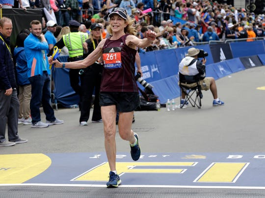 Kathrine Switzer, who was the first official woman entrant in the Boston Marathon 50 years ago, crosses the finish line in the Boston Marathon on Monday.