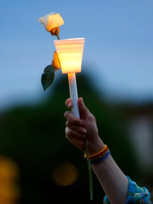 Area residents attend a vigil at QSpot Community on Main Street in Ocean Grove on Monday for the victims of the Orlando nightclub shooting.