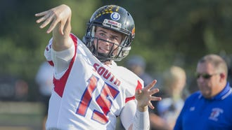 South's Quarterback Cameron Misner (15) warms up his arm before the IFCA North-South All-Star game at North Central High School on Friday, July 13, 2018.