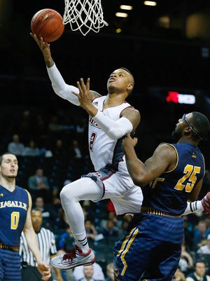 Massachusetts guard Derrick Gordon, center, is expected to participate in a discussion held by the 'You Can Play' project at the Final Four in Indianapolis.