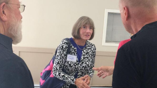 Pat Finnigan speaks with residents of Ogunquit, Maine, in July 2017 during a meet and greet prior to her hiring.