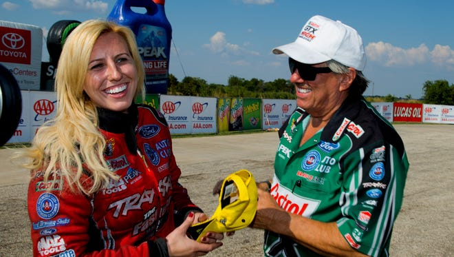 Courtney Force, left, and father John Force are still in contention to win the NHRA Funny Car title. John Force ranks second and Courtney third heading into this weekend's season finale.