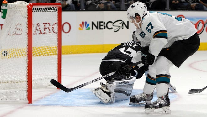 San Jose Sharks center Tommy Wingels scores on Los Angeles Kings goalie Jonathan Quick during the second period.