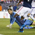 Sep 5, 2015; Foxborough, MA, USA; New England Revolution forward Juan Agudelo (17) scores on Orlando City FC goalkeeper Tally Hall (22) during the second half of the New England Revolution's 3-0 win over the Orlando City FC at Gillette Stadium. Mandatory Credit: Winslow Townson-USA TODAY Sports