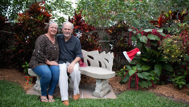 Phyllis and Larry McCommon host a Christmas party in their Naples garden each year, which they decorate for the occasion with lights, Santa hats and big, red bows.