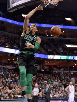 FILE == Boston Celtics forward Jayson Tatum dunks the ball in the second half of an NBA basketball game against the Memphis Grizzlies, Saturday, Dec. 16, 2017,